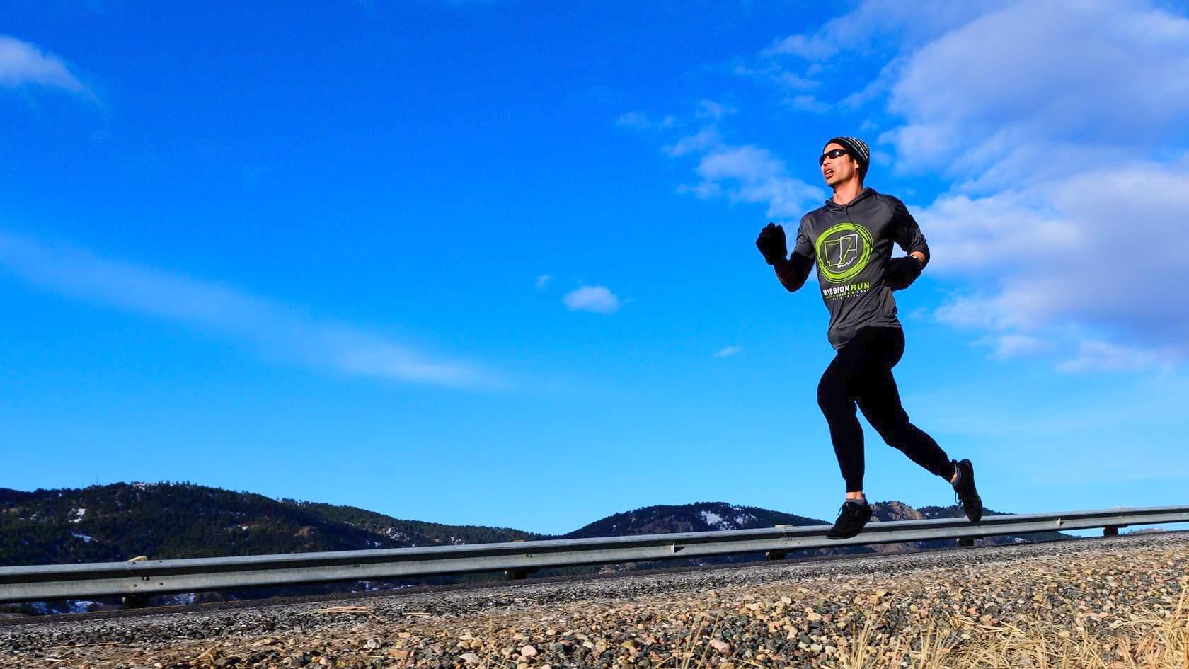 Felix Wong running down a mountain road