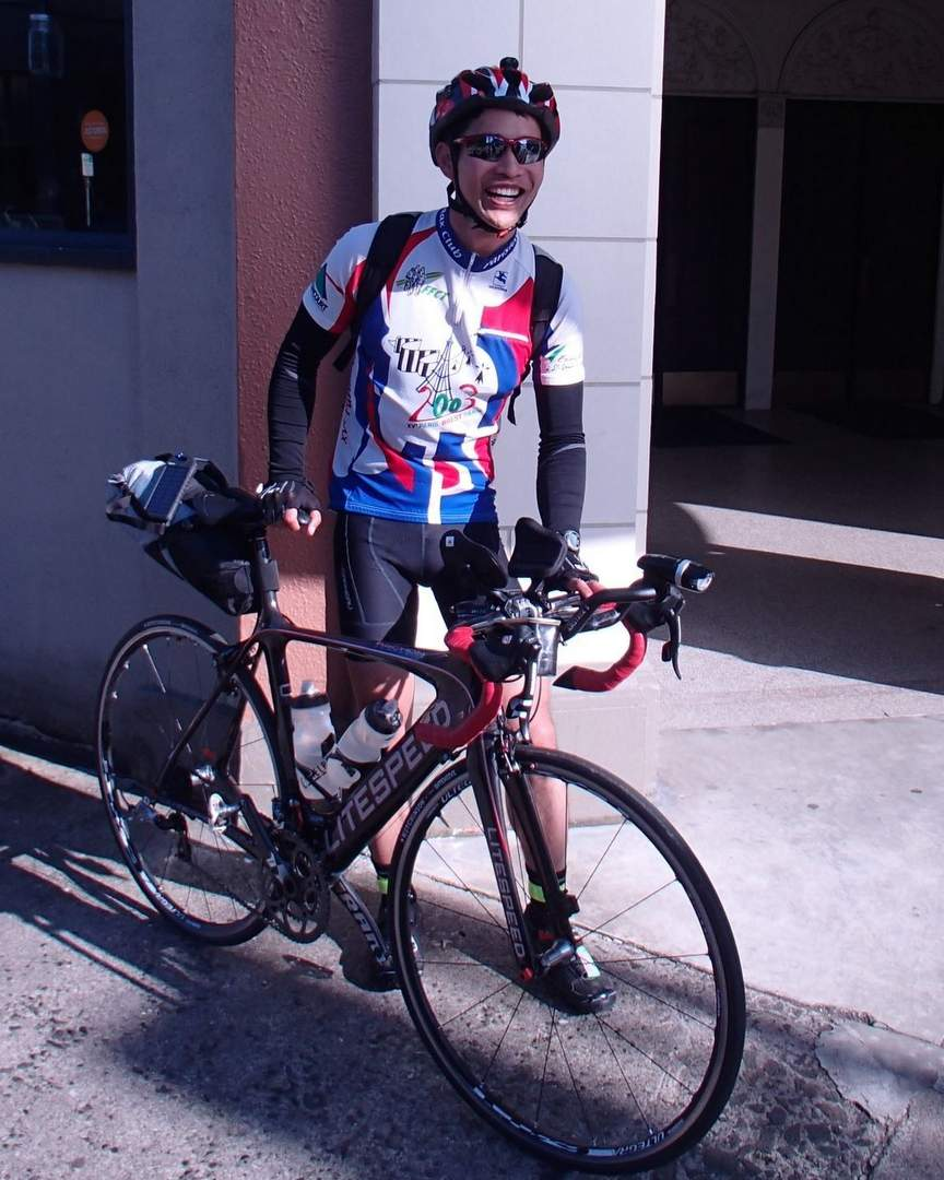 Felix Wong with carbon road bike and bikepacking setup