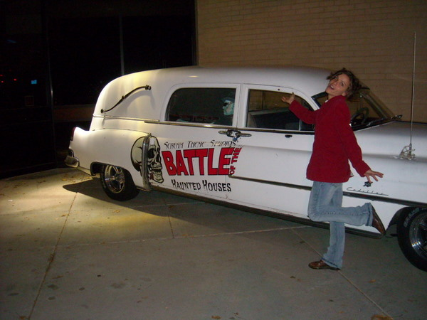 Leah in front of a Hearse.