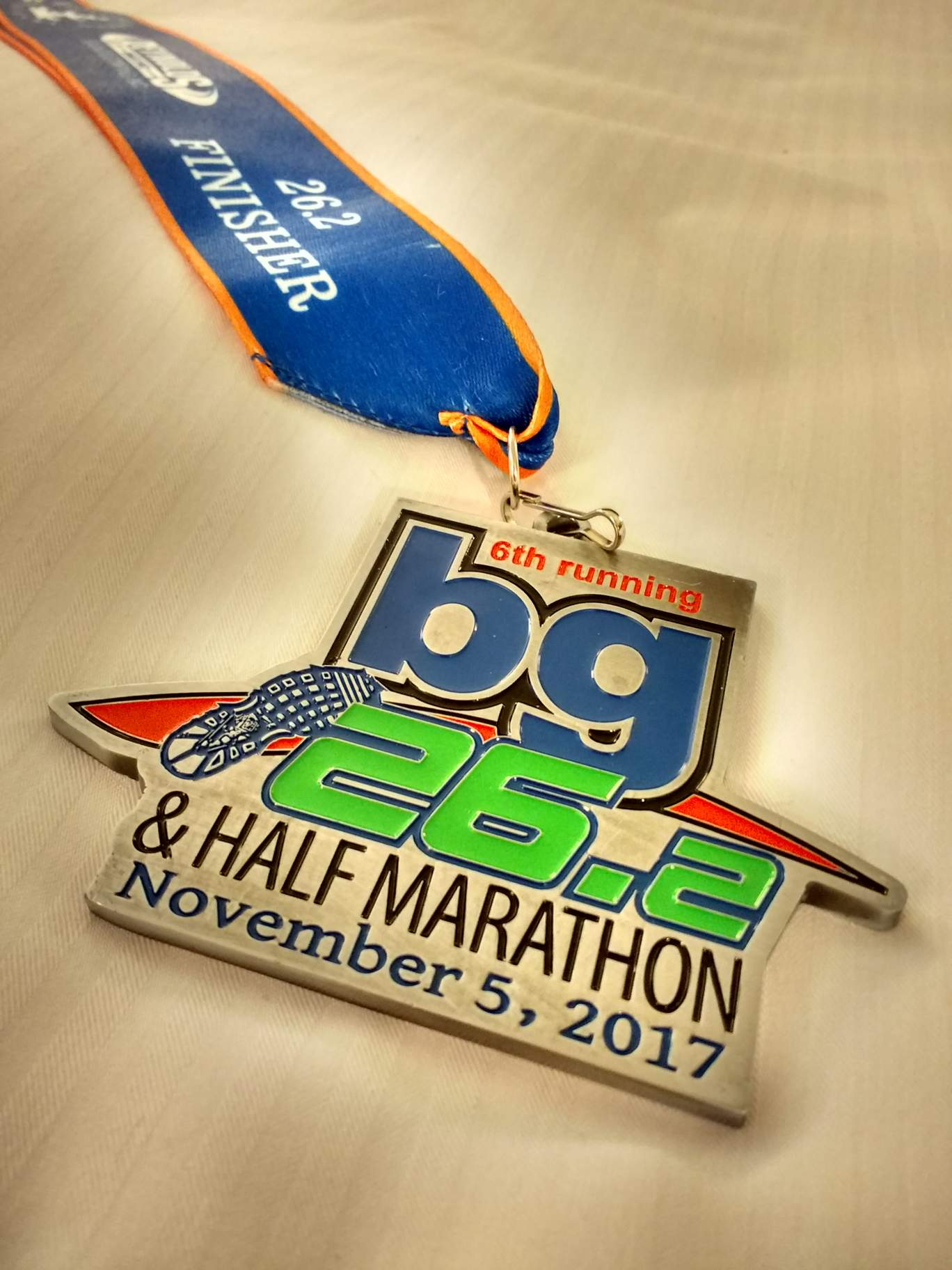 The medal for the 2017 Bowling Green Marathon (BG 26.2) and Half Marathon.