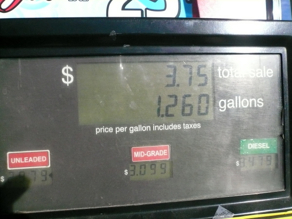 $3.75 fill-up, 1.26 gallons, gas pump