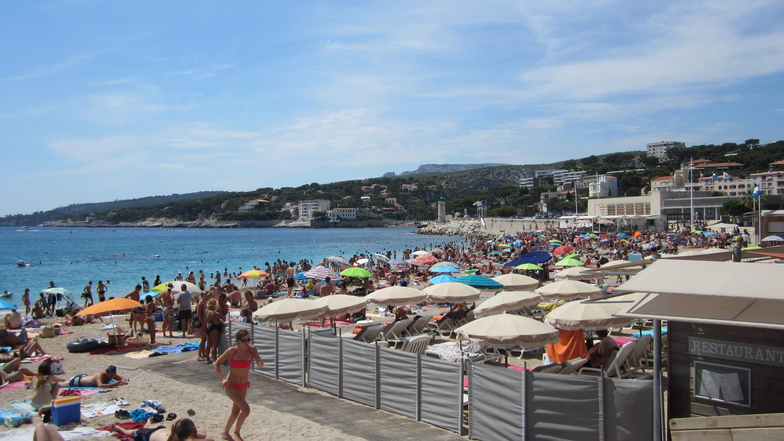 The beach in Cassis was teeming with people.