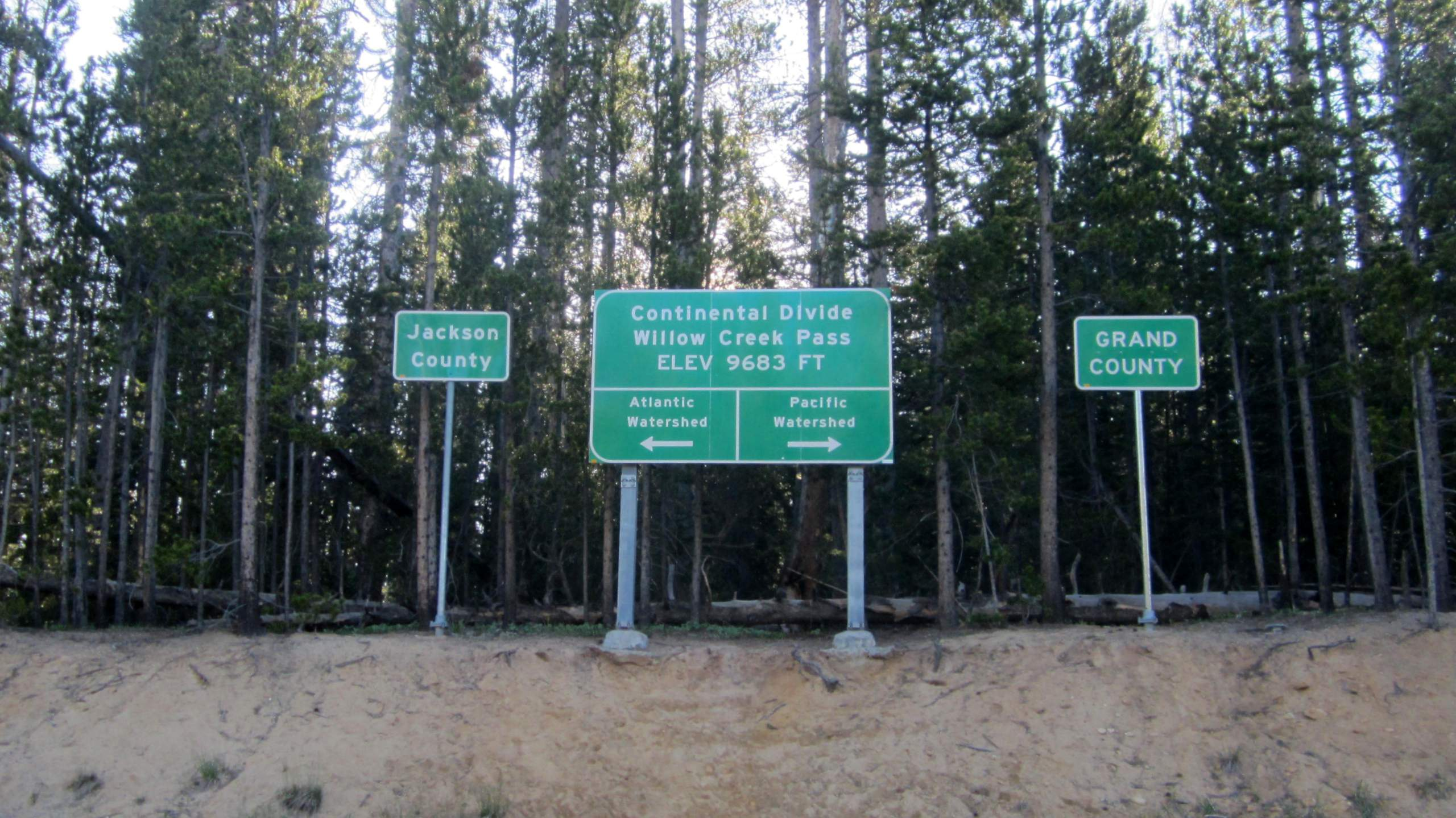 green road signs, Continental Divide, Willow Creek Pass