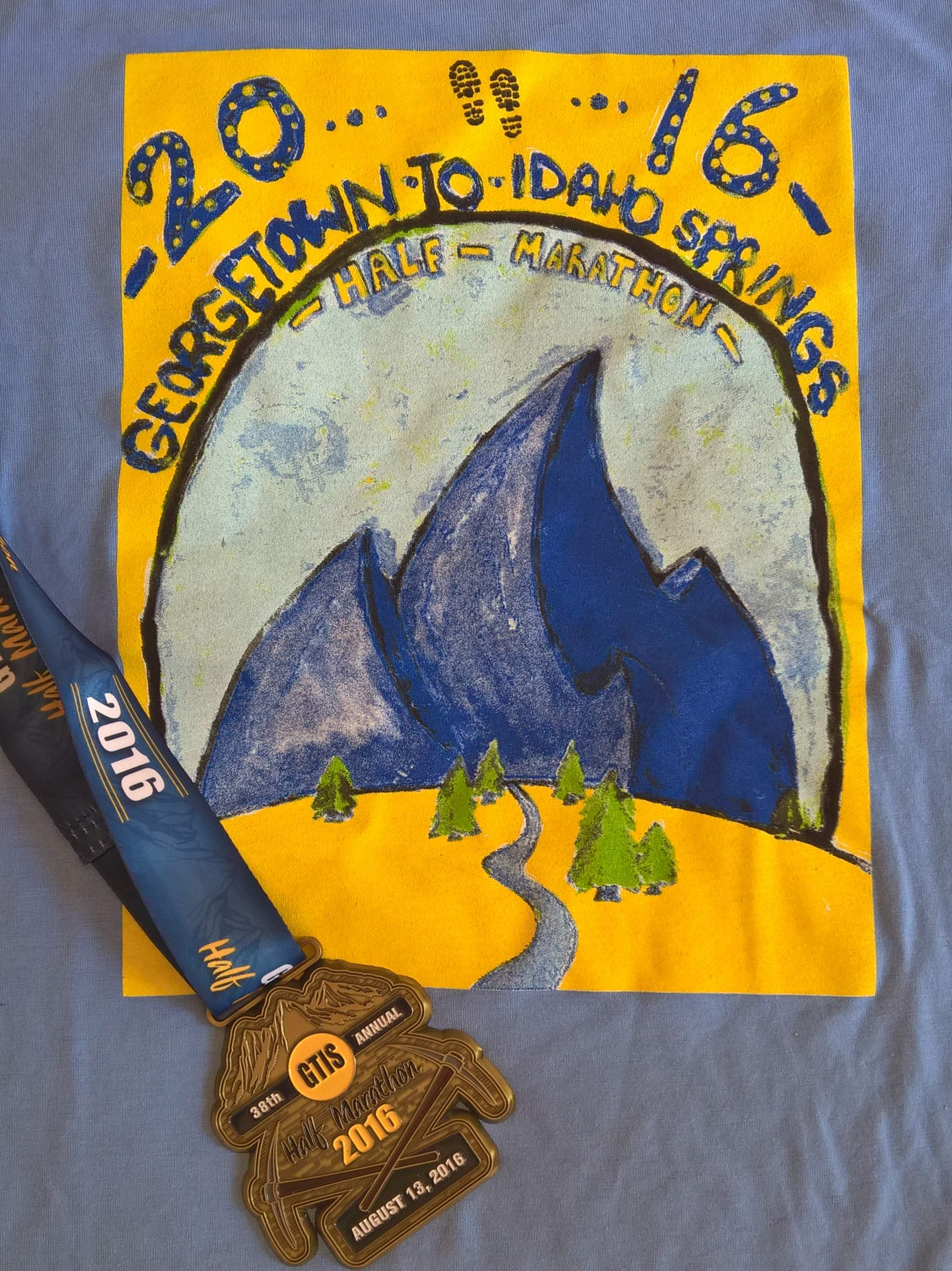 The 2016 Georgtown-Idaho Springs Half Marathon t-shirt and medal.