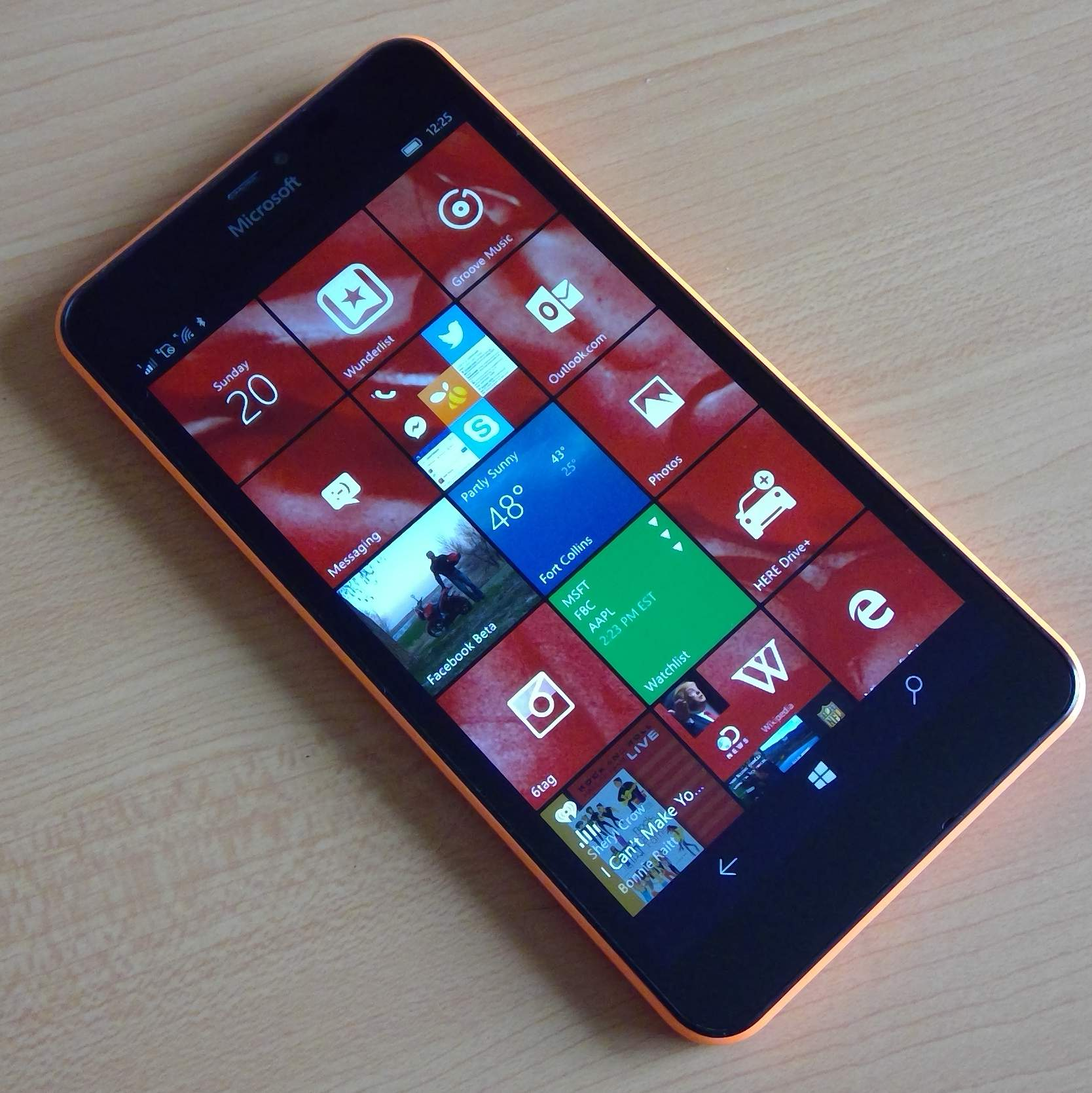 orange Microsoft Lumia 640 XL, red live tiles, Windows 10 Mobile