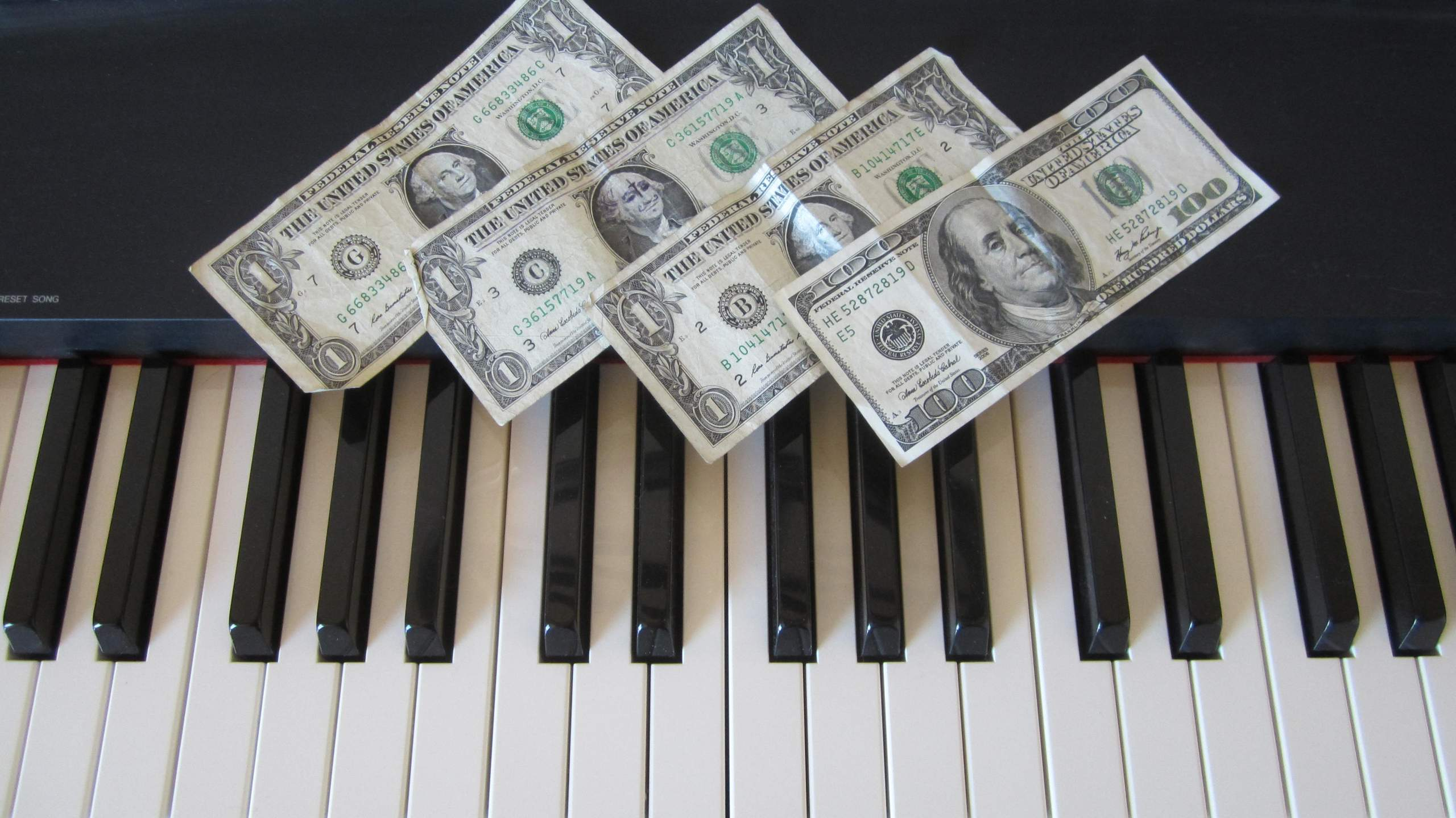 money, dollars, piano keyboard