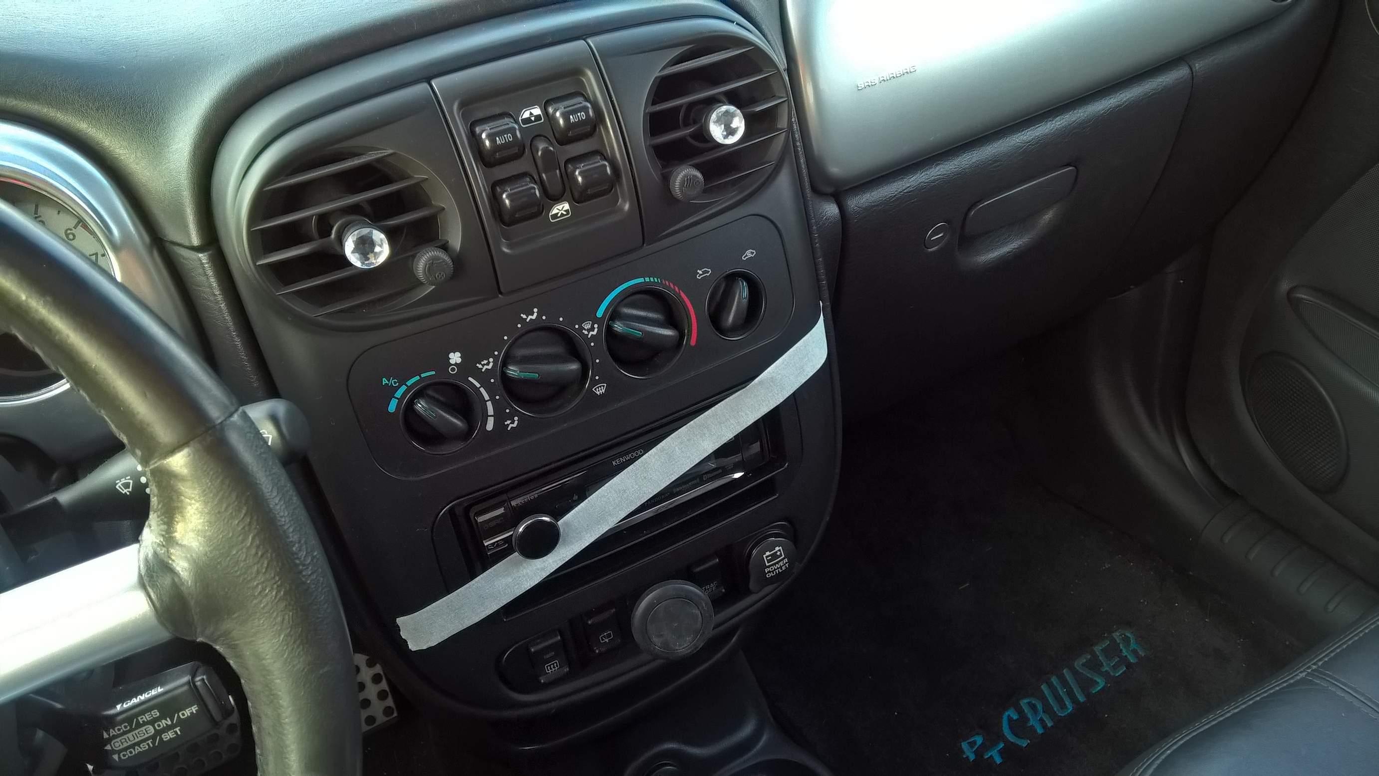 PT Cruiser interior, masking tape over radio