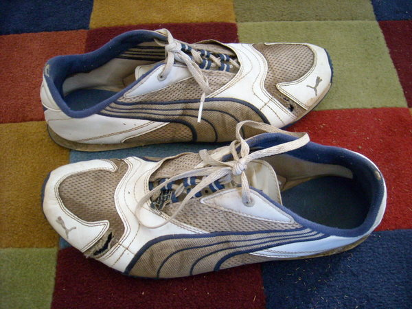 Puma Salohs running shoes, tears, holes after 700 miles.