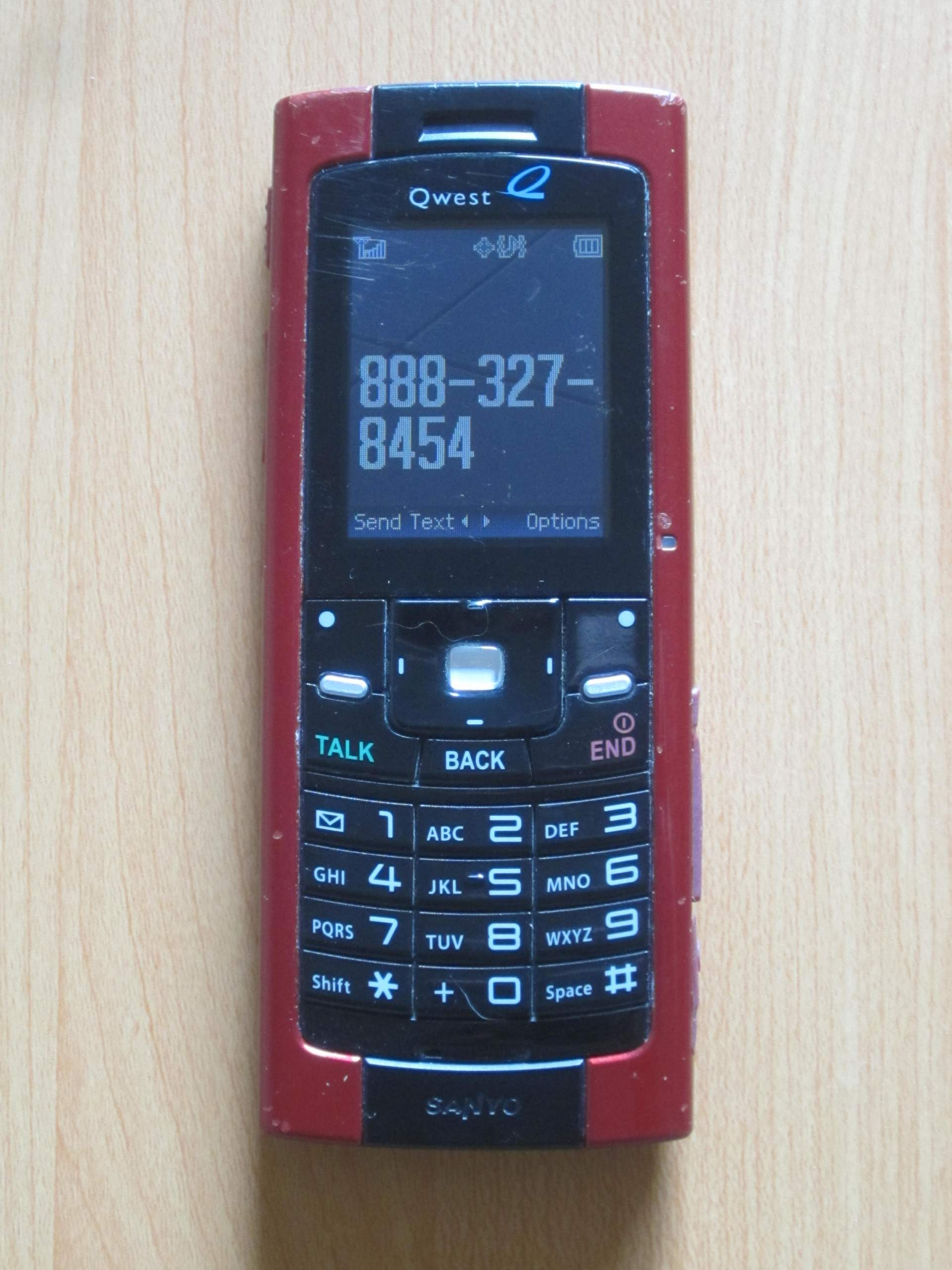 red Sanyo Qwest bar phone, 888-327-8454