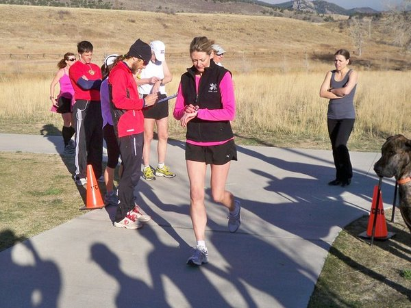 Leah (on right) awaits her turn as another runner starts and dog Griffin looks on. Photo: Fort Collins Running Club.