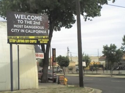 """Welcome to the 2nd most dangerous city in California"" read a billboard erected by Stockton Police.  Photo: News10 ABC."