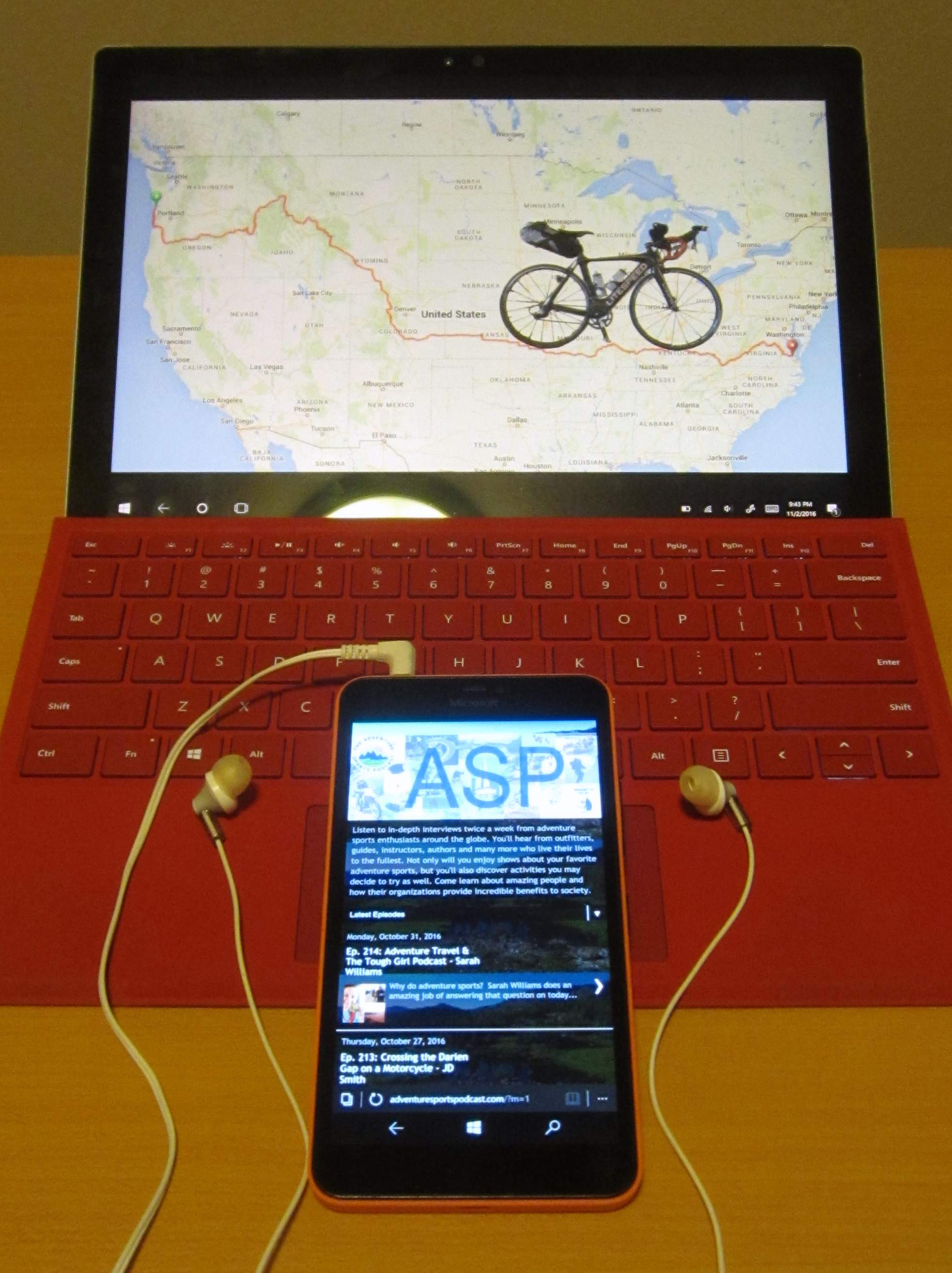 Red Microsoft Surface Pro 4 with Lumia 640 XL playing ASP podcast.