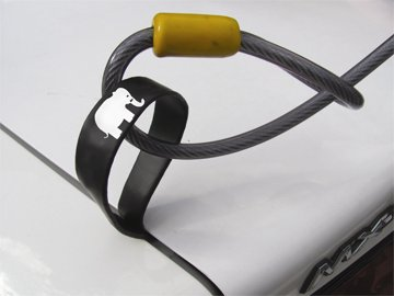 A Trunk Lock enables you to lock your trunk-mounted bicycle (and bike rack) to your car. Photo: BicycleTrunkLocks.com.