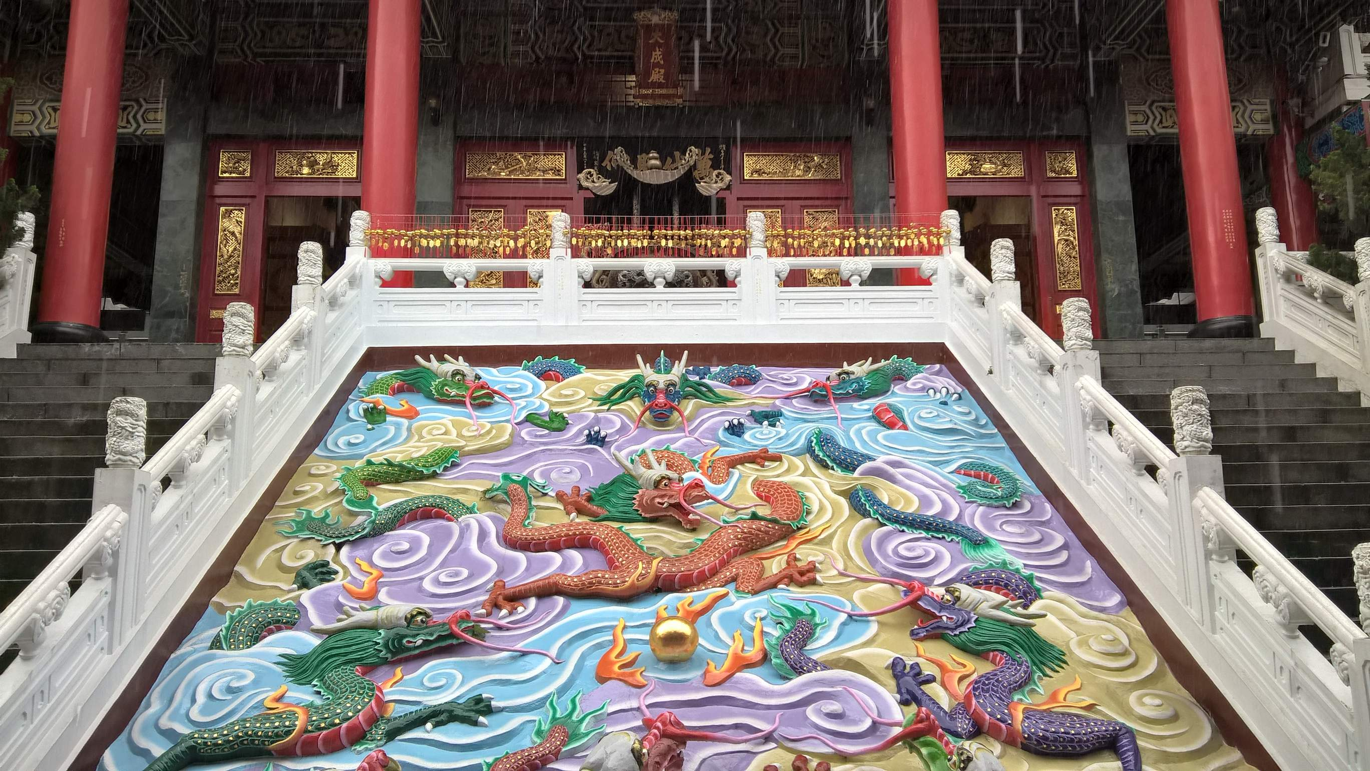 Outdoor painted carvings of dragons at the Wen Wu Temple in Yuchi Township, Taiwan.