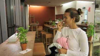 Katia enjoying the smell of basil in Vapiano.
