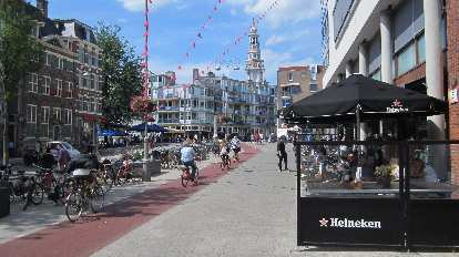 Typical Amsterdam: red bike trails and Heineken.