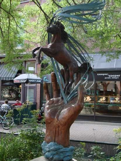A horse on a hand in Old Town Plaza.