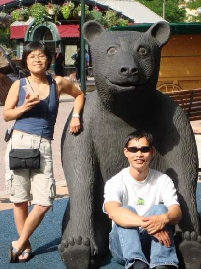 Stacey and Felix Wong with a bear.