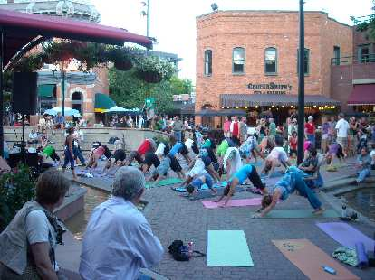 When we passed by Old Town Square, dozens of people were doing down dog.  It was part of Yoga Fest.