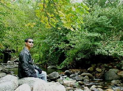 Felix Wong in front of a creek passing through Lithia Park.
