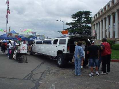 An obnoxious Hummer H2 limousine.