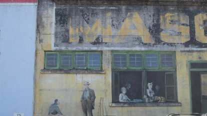 yellow and green mural on building in Astoria, Oregon