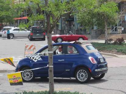 Fiat 500 Cabrio, the first one I've seen in the flesh.  Note the retracting old-school soft top.