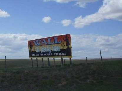 [Mile 94, 2:00 p.m.] One of the many Wall Drug billboards outside of the Badlands National Park.