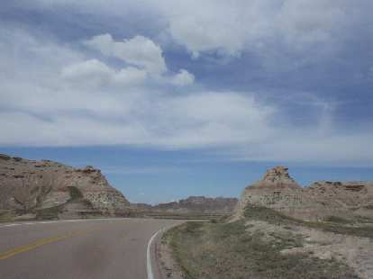 [Mile 73, 11:57 a.m.] Now back on course and going through the rock/dirt formations of the Badlands.