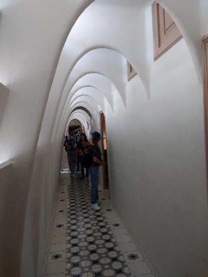 Hallway in Casa Balló, with white archways.