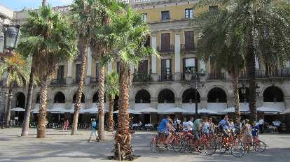 A cycle tour group congregating in a plaza not far from La Rambla.