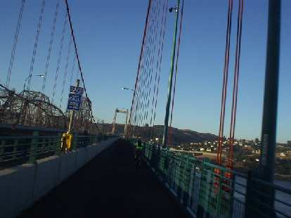 [Mile 19, 6:45 a.m.] AJ on the Benicia Bridge over to San Pablo Rd.  We'd get within 1 mile of my friend Lisa's house, but sadly, it was just too early to stop on by!