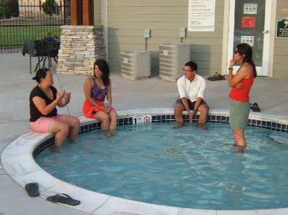 Kiri, Lauren, Dan and Susie in the wading pool.