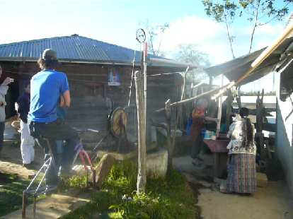 Bruce pedaling a bicibomba (bicycle water pump) in a rural area west of San Andres Itzapa.