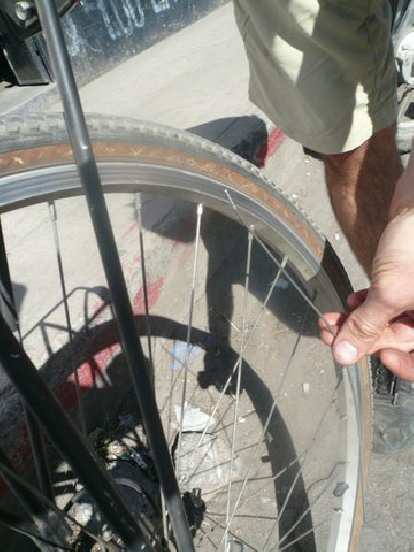 In Chimaltenango, we notice my bike had broken a rear spoke -- probably early on during the ride on the cobblestones of Itzapa.