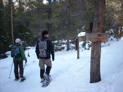 """Tori, Lisa and Rob next to a """"Leaving Travel Zone"""" sign."""