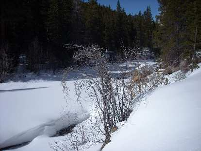 Belying a couple feet of snow here was the Poudre River.E1673