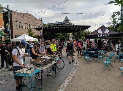 Several businesses were represented in Old Town Square for Bike to Work Day, including casual apparel-maker Akinz.