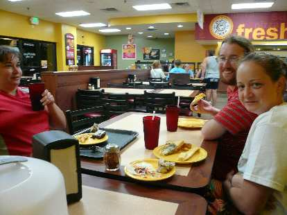 Christy, Jesse, and Ryan having some special-order pizza.