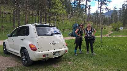 vanilla 2005 Chrysler PT Cruiser GT, ladies wearing backpacks, Willow Creek trailhead, Black Hills, South Dakota