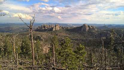 The Cathedral Spires and Little Devils Tower as seen from Harney Peak.