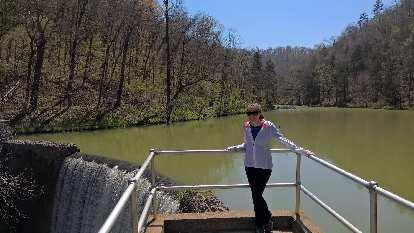 Maureen at the lake and waterfall at Blanchard Springs Recreational Area.