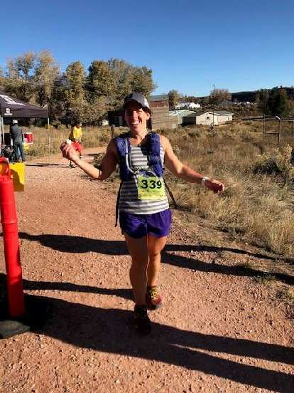 Jennifer after crossing the finish line of the 2018 Blue Sky Trail Marathon.