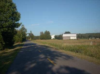 [Mile 392] Riding past more farms in the province of Quebec.