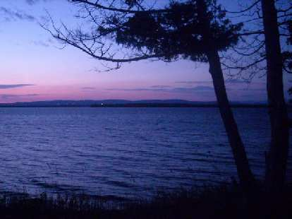 [Mile 435] Pink sunrise over water in Vermont.