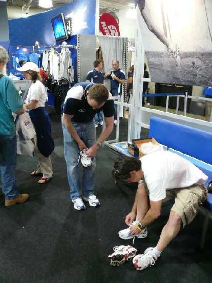 At the Boston Marathon expo, Eddie tried on some Mizuno shoes...