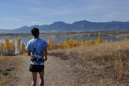 [Mile 96.5, 10:32 a.m.] Running back towards the Boulder Reservoir, golden aspens and iconic Flatirons for one last time.