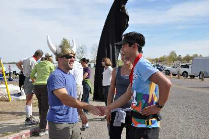 [Mile 100, 11:57 a.m.] Finally, FINISHED!  Being congratulated by the Viking race director. It took me 26hrs 57min to go 100 miles, including zero sleep.