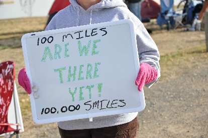 "[Mile 93, 9:40 a.m.] ""100 miles, are we there yet!""  Not sure about the 100,000 smiles."