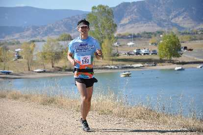 [Mile 15, 11:59 a.m.] Running by the Boulder Reservoir, still feeling fresh.